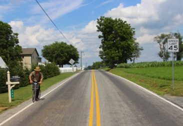 An Amish man on a bicycle