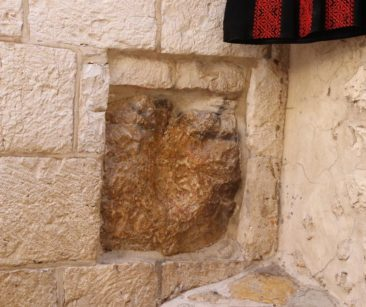 A stone on Via Dolorosa where Jesus placed His hand