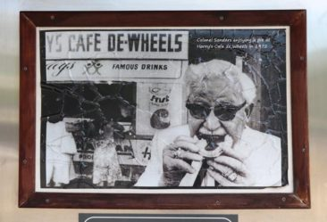 KFC's Colonel Sanders enjoying a pie at Harry's Cafe de Wheels