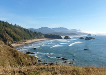 The view from Ecola State Park with Haystack Rock and Cannon Beach in the distance